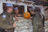 A touch of home on Hallowe'en in Croatia: Private Jason Andrews carves while Sergeant Steve Little and Corporal Fritz supervise, 1993. (SUPPLIED)