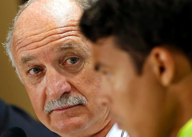 Brazil's national soccer head coach Luiz Felipe Scolari (L) attends a news conference with player Thiago Silva a day before their World Cup soccer match against Chile at the Mineirao stadium in Belo Horizonte June 27, 2014. (REUTERS/Eric Gaillard)
