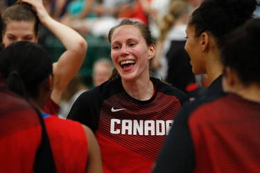 Canada guard Kim Gaucher (centre) smiles after receiving the Team Canada player of the game award after the team beat Brazil in the 2014 Edmonton Grads International Classic game held at the Saville Community Sports Centre at the University of Alberta in Edmonton, Alta., on Friday June 27, 2014. Team Canada won 79-72. The teams meet again on June 28. Ian Kucerak/Edmonton Sun/QMI Agency
