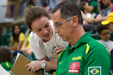 """Brazil's assistant coach, Chantal Vallee, left, speaks with physical trainer """"Vita"""" Clovis Roberto Haddad, right, during the Edmonton Grads International Classic basketball tournament at the Saville Community Sports Centre in Edmonton, Alta., on Thursday, June 26, 2014. Vallee is from Windsor, Ontario. Codie McLachlan/Edmonton Sun/QMI Agency"""