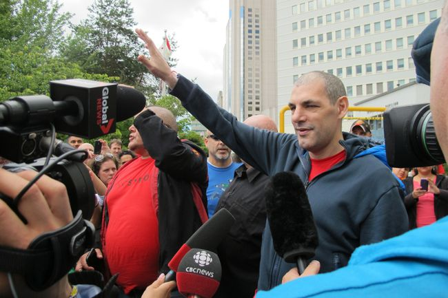 """Former NHL player Gino Odjick says he's """"overwhelmed"""" by the attention from hundreds of well-wishers outside Vancouver General Hospital, where the Canuck enforcer battles a terminal illness. (Michael Mui/QMI Agency)"""