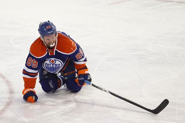 Edmonton Oilers forward Sam Gagner grimaces in pain before leaving the ice during the second period of the game at Rexall Place in Edmonton, Alta., on Wednesday, April 24, 2013. Ian Kucerak/Edmonton Sun/QMI Agency