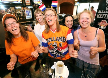 (left to right) Netherlands soccer fans Sandra Dakurah, Corinne Vollrath - Link, Miranda Smit, Milena Blanes, and Christina Leinmueller sing a team song as they watch the Netherlands and Mexico 2014 FIFA World Cup game at The Pint Public House, 10125 - 109 St., in Edmonton Alta., on Sunday June 29, 2014. David Bloom/Edmonton Sun/QMI Agency