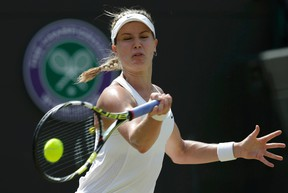Eugenie Bouchard hits a shot against Angelique Kerber in a Wimbledon quarterfinal. (Max Rossi, Reuters)
