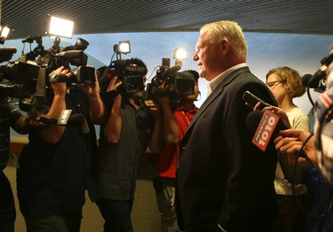 Councillor Doug Ford is flanked by media and slams most of them for their questions and comments on Wednesday, July 2, 2014. (VERONICA HENRI/Toronto Sun)