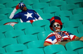 U.S. fans show dejection at the end of the extra time of the 2014 World Cup round of 16 game between U.S. and Belgium at the Fonte Nova arena in Salvador July 1, 2014. (REUTERS/Sergio Moraes)