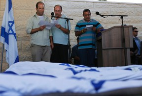 Avi Fraenkel, Ofir Shaer and Ori Yifrah (L-R), fathers of the three Israeli teens who were abducted and killed in the occupied West Bank, read their eulogies during their sons' joint funeral in the Israeli city of Modi'in July 1, 2014. Tens of thousands of mourners joined in an outpouring of national grief on Tuesday at the burial of the three Israeli teenagers, Gil-Ad Shaer, U.S.-Israeli national Naftali Fraenkel, both 16, and Eyal Yifrah, 19, whose kidnapping and killing Israel blamed on the Palestinian Islamist group Hamas. The Islamist group has neither confirmed nor denied involvement in the disappearance of the students as they hitchhiked near a Jewish settlement on June 12 nor in the cross-border rocket salvoes from Gaza. REUTERS/Baz Ratner