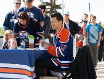 Edmonton Oilers' Andrew Ference signs autographs