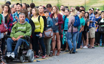 Crowds line up to get in to the grounds on opening night at Bluesfest. July 3, 2014. Errol McGihon/Ottawa Sun/QMI Agency