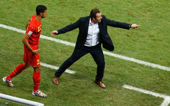 Belgium's coach Marc Wilmots gestures as Nacer Chadli (left) enters the field to substitute teammate Eden Hazard during extra time in their World Cup round of 16 game against the U.S. at the Fonte Nova arena in Salvador, Brazil on Tuesday, July 1, 2014. (Ruben Sprich/Reuters)