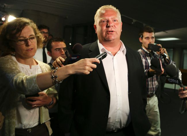 Councillor Doug Ford is flanked by media on July 2, 2014. (VERONICA HENRI/Toronto Sun)