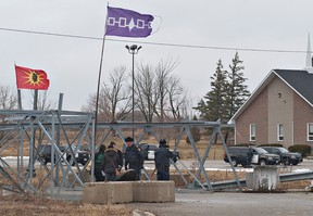 A large number of Ontario Provincial Police officers arrived in Caledonia, Ontario on Friday, January 27, 2011 ahead of a planned rally by protester Gary McHale at the Douglas Creek Estates reclamation site.  McHale was arrested after posting racist signs at the site where, in February 2006, native activists occupied a residential construction site.  BRIAN THOMPSON/BRANTFORD EXPOSITOR