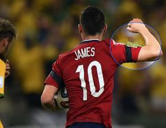 Colombia's James Rodriguez scored a goal and made a friend against Brazil in Fortaleza on Friday. (FABRICE COFFRINI/AFP)