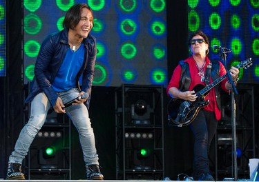 Arnel Pineda (L) and original member Neal Schon of Journey performing at Bluesfest on Friday July 4, 2014. Errol McGihon/Ottawa Sun/QMI Agency