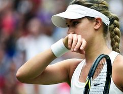 Eugenie Bouchard wipes her face during the Wimbledon women's singles final against Petra Kvitova at the All England Club in London, July 5, 2014. (TOBY MELVILLE/Reuters)