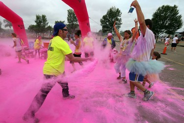 Runners run through a colour station during the Colour Me Rad Race at Northlands in Edmonton, Alberta on Saturday, July 5, 2014.  Perry Mah/Edmonton Sun/QMI Agency