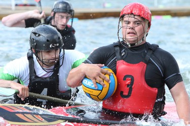 Participants compete in the National Canoe Polo Championships held in Rundle Park AB, on Saturday, July 5, 2014. The competition was held in two ponds from July 4 to 6.