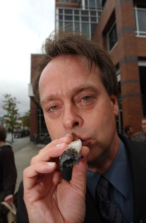 "The ""Prince of Pot"" Marc Emery smokes a 15 gram joint during a protest in front of the police department September 18, 2003 in Vancouver, Canada. FIle photo"