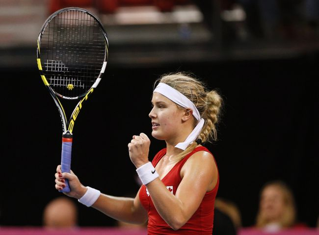 Canada's Eugenie Bouchard celebrates after defeating Slovakia's Jana Cepelova during their Fed Cup tennis match at the PEPS stadium at Laval University on April 20, 2014. (REUTERS/Mathieu Belanger)