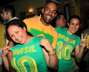 Tedam Brtazil fans cheers as they watched World Cup action on TV at Azucar Picante Restaurant & Cantina at 13062 50 St., in Edmonton, Alta., on Friday, July 4, 2014. Brazil beat Colombia 2-1 in FIFA World Cup playoffs. Hugo Sanchez/Edmonton Sun Reader