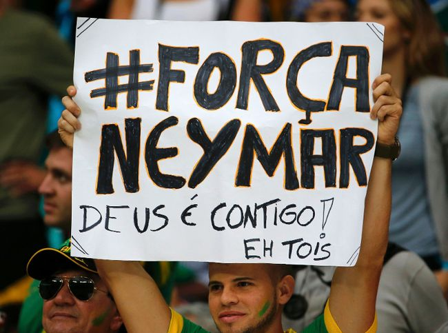 "A fan holds up a poster reading, ""#Strength Neymar, God is with you"", before the 2014 World Cup quarter-finals between Costa Rica and the Netherlands at the Fonte Nova arena in Salvador July 5, 2014. (REUTERS/Sergio Moraes)"