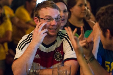 Germany fan Tobias Weiss celebrates a goal while watching the World Cup semifinal between Germany and Brazil with friends at The Pint pub on 109 Street in Edmonton, Alta., on Tuesday, July 8, 2014. Germany won the game 7-1. Ian Kucerak/Edmonton Sun/QMI Agency