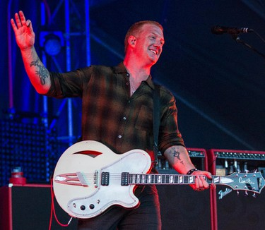 Queens of the Stone Age frontman Josh Homme performing at Bluesfest in Ottawa on Tuesday July 8, 2014. Errol McGihon/Ottawa Sun/QMI Agency