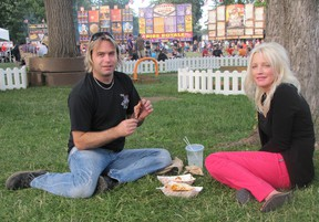 Joel Laprise and Julie Richmond enjoy a picnic on the grass at Tecumseh Park on July 5 during Chatham-Kent Ribfest. This year's event benefitted from warm, dry weather and attendance was up.
