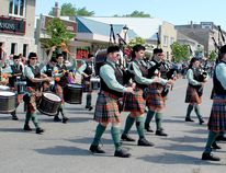 The Midlothian Scottish Pipe Band marches up Queen Street during the Kincardine Scottish Festival and Highland Games on July 5, 2014.