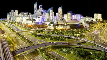 """Mall of the WorldBut the Dubai Mall's record won't last long. According to plans recently unveiled by Dubai Holding, the Mall of the World won't just be larger, it will be designed to look like """"a self-contained city within a city."""" Among its many features Dubai Holding plans to build the world's largest indoor theme park and 100 hotel buildings within the mall. (Dubai Holding, Mall of the World)"""