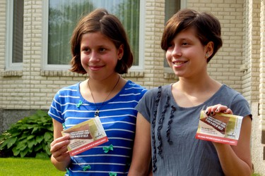 Sisters Sarah (left) and Brittany Gatz are spending a week of their summer holidays helping Winnipeg Harvest and the Latter-day Saints with the food bank's largest summer food drive.