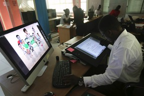 An illustrator works on a digital drawing board at the Kuluya Games office at Anthony district in Nigeria's commercial capital of Lagos June 16, 2014.  REUTERS/Akintunde Akinleye