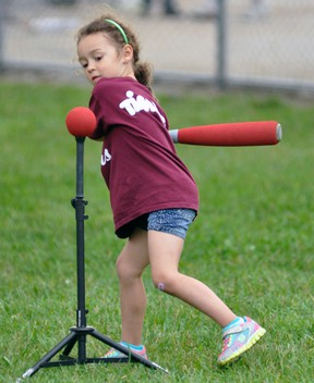 Cambell Ward prepares to take a mighty swing. ANDY BADER/MITCHELL ADVOCATE