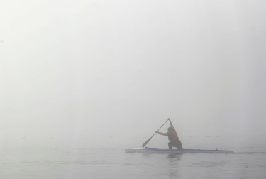 The Cobourg Dragon Boat and Canoe Club. youth competitive members were out practicing on a foggy morning in the inner harbour of Cobourg, Ont. on Tuesday morning, July 8, 2014. The members were using racing kayaks/Olympic kayaks.  Most of the members aged 11-16-years old have won gold medals during provincial competition. (Pete Fisher/QMI Agency)