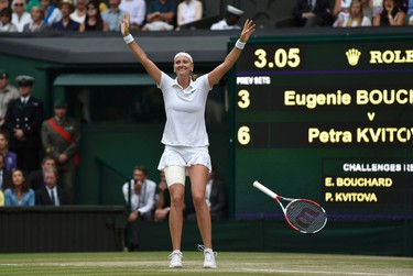 Petra Kvitova of the Czech Republic celebrates after defeating Eugenie Bouchard of Canada  in their women's singles final tennis match at the Wimbledon Tennis Championships, in London July 5, 2014.   REUTERS/Toby Melville