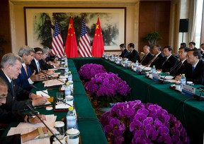 U.S. Secretary of State John Kerry (3rd L), speaks next to U.S. Treasury Secretary Jack Lew (4th L) as they attend the Climate Change issue joint conference with Chinese State Council Yang Jiechi (R) at the Fanghuayuan Hall,  Diaoyutai State Guest House in Beijing July 9, 2014.   REUTERS/Andy Wong/Pool