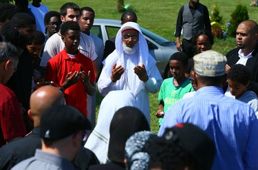 Hundreds gather for the burial at Beechwood Cemetery for supply teacher Abshir Hassan, 31, who was gunned down in a triple shooting in Lawrence Heights Tuesday on Friday July 11, 2014. Dave Abel/Toronto Sun/QMI Agency