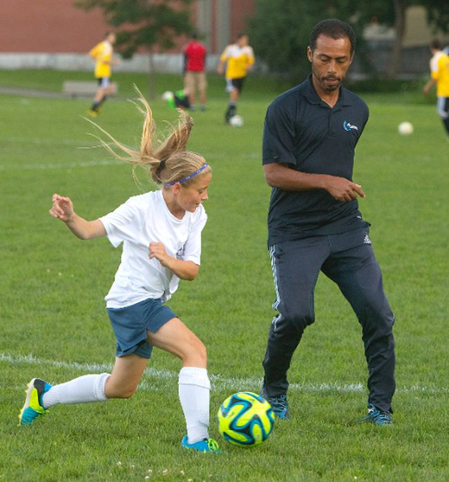 Coach Jose (Garrincha) Figueiredo works with Hailey Burke during a practice for the AG London under-12 girls' team on Wednesday. (Mike Hensen/The London Free Press)