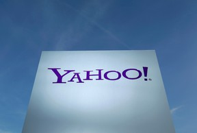 A Yahoo logo is pictured in front of a building in Rolle, 30 km (19 miles) east of Geneva, in this file picture taken December 12, 2012. (REUTERS/Denis Balibouse)