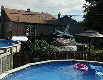 A small single-engine plane crashed into a residential backyard in the district of Saint-Hubert, Longueuil, on July 12, 2014.