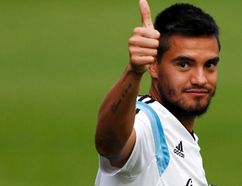 Argentina's goalkeeper Sergio Romero gives a thumbs-up as he arrives for a training session ahead of their 2014 World Cup final match against Germany in Vespasiano, July 10, 2014. (REUTERS/Marcos Brindicci)