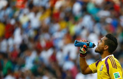 Argentina's goalkeeper Sergio Romero drinks water at the half-time break during their 2014 World Cup final against Germany at the Maracana stadium in Rio de Janeiro July 13, 2014. (REUTERS/Kai Pfaffenbach)