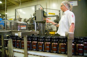 Julia McMenamin a line maintainer at McCormicks checks the La Grille Montreal Steak Spice line at the London spice production facility in London, Ont. on Friday July 11, 2014. (MIKE HENSEN, The London Free Press)