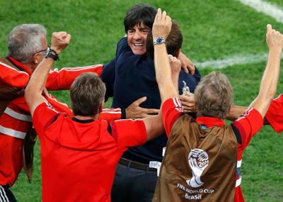 Germany's coach Joachim Loew celebrates with his team members after Mario Goetze scored against Argentina during extra time in their 2014 World Cup final at the Maracana stadium in Rio de Janeiro July 13, 2014. (REUTERS/Paulo Whitaker)
