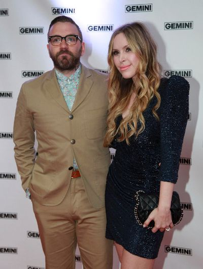 Leah Miller poses with her husband Alexisonfire/City and Colour musician Dallas Green on the red carpet at the 26th Gemini Awards in Toronto, September 7, 2011. (REUTERS/Brett Gundlock)