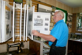 National Communities in Bloom judge Gerry Teahen looks at some of the artifacts at the Draytom Valley and District Historical Society Museum last week during the Communities in Bloom tour of Drayton Valley on July 9.