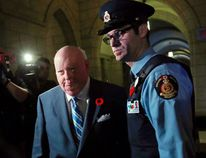 Senator Mike Duffy arrives at the Senate on Parliament Hill in Ottawa in this October 28, 2013 file photo. The Senate voted November 5, 2013 to suspend senators Duffy, Patrick Brazeau and Pamela Wallin without pay. REUTERS/Chris Wattie/Files