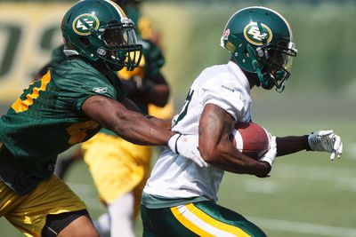 Linebacker Deon Lacey (40) chases wide receiver AJ Guyton (82) during an Edmonton Eskimos practice at Commonwealth Stadium in Edmonton, Alta., on Tuesday, July 15, 2014. The team plays the Winnipeg Blue Bombers in Winnipeg on Thursday, July 17. Ian Kucerak/Edmonton Sun/QMI Agency
