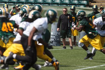Head coach Chris Jones (centre right) watches players during an Edmonton Eskimos practice at Commonwealth Stadium in Edmonton, Alta., on Tuesday, July 15, 2014. The team plays the Winnipeg Blue Bombers in Winnipeg on Thursday, July 17. Ian Kucerak/Edmonton Sun/QMI Agency
