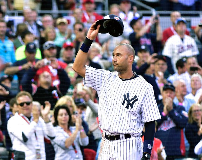 American League shortstop Derek Jeter of the New York Yankees waves to the crowd as he is replaced in the fourth inning during the MLB All Star Game at Target Field in Minneapolis, July 15, 2014. (SCOTT ROVAK/USA Today)
